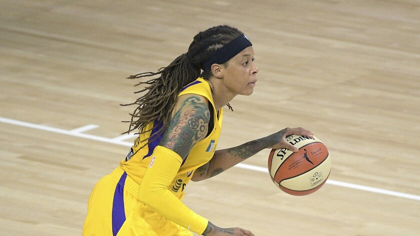 Sparks guard Seimone Augustus brings the ball up the court against the Phoenix Mercury.