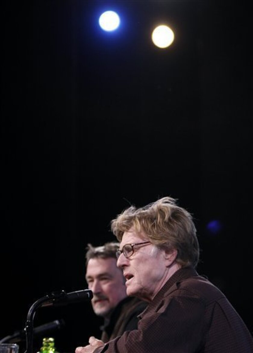 Robert Redford, right, speaks as Geoffrey Gilmore, director of the Sundance Film Festival, looks on during a news conference on the first day of the Sundance Film Festival in Park City, Utah, on Thursday, Jan. 15, 2009. (AP Photo/Matt Sayles)