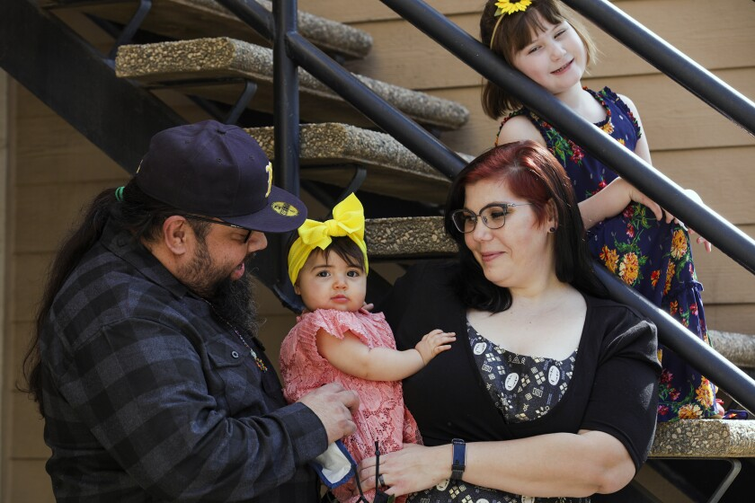 UC Riverside student Yvonne Marquez, 36, center, with her husband Gilbert Marquez and daughters Vivian and Ramona.
