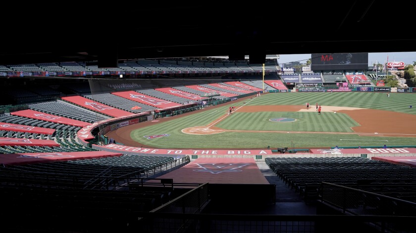 Grounds crew work to prepare Angel Stadium for a baseball game on Sept. 20.