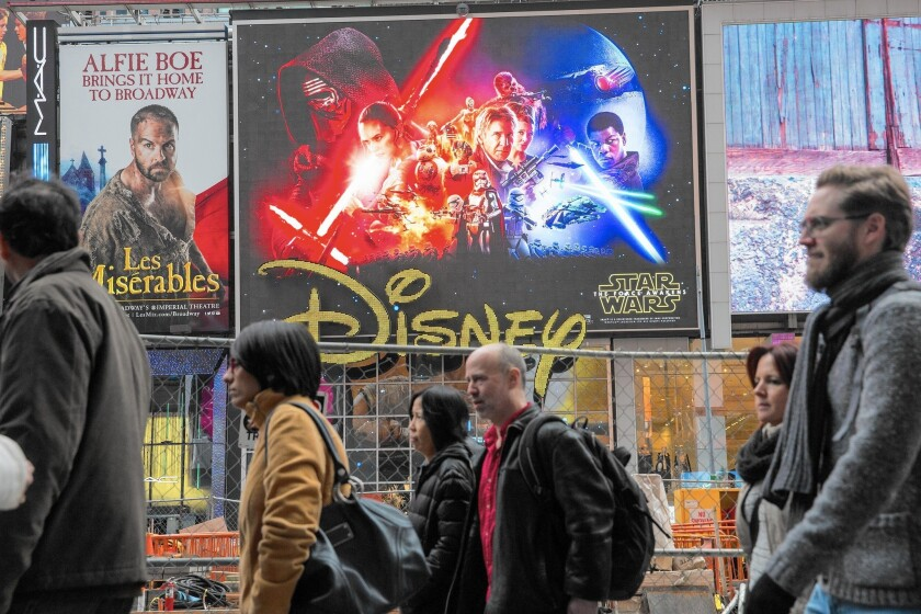 "An ad for ""Star Wars: The Force Awakens"" hangs in New York's Times Square. The film, which opens Friday, is expected to earn $1.5 billion to $2 billion in global box-office returns."