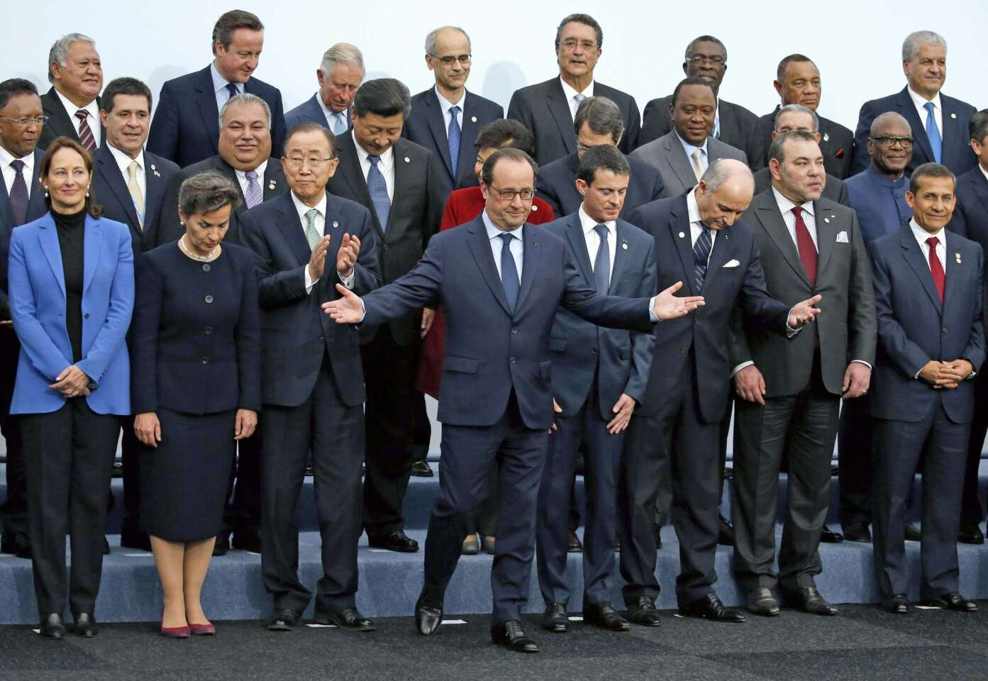French President Francois Hollande gestures when posing with world leaders for a photo during the opening day of the World Climate Change Conference 2015 near Paris.