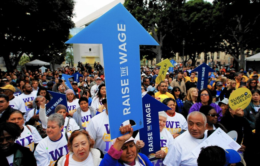 Workers, as well as business and civic leaders, rally outside L.A. City Hall in January, urging the City Council to raise the minimum wage.