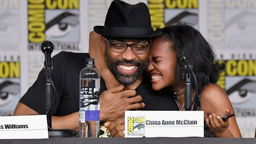 "Cress Williams and China Anne McClain speak at the ""Black Lightning"" special video presentation and Q&A during Comic-Con International 2018."