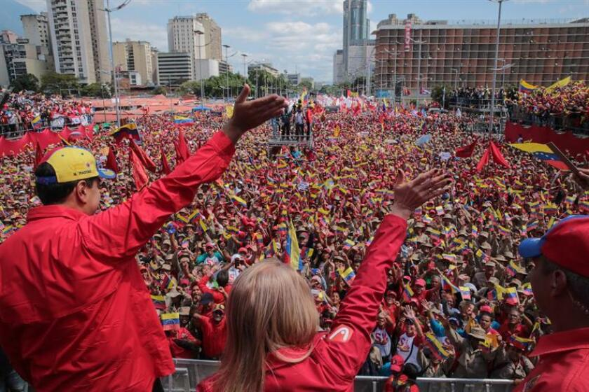Nicolas Maduro (l.) on Saturday, Feb. 2, 2019, in Caracas leads a rally where he vows, 20 years after the Bolivarian Revolution, to defend the homeland, just as National Assembly leader Juan Guaido did some 10 days ago when he announced he was assuming the position of acting president of the nation. EFE-EPA/Miraflores Press