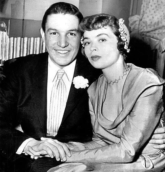 Mike Wallace poses with his second wife, Buff Cobb, the day after their wedding. Wallace met Cobb, an actress, while interviewing her on WGN.