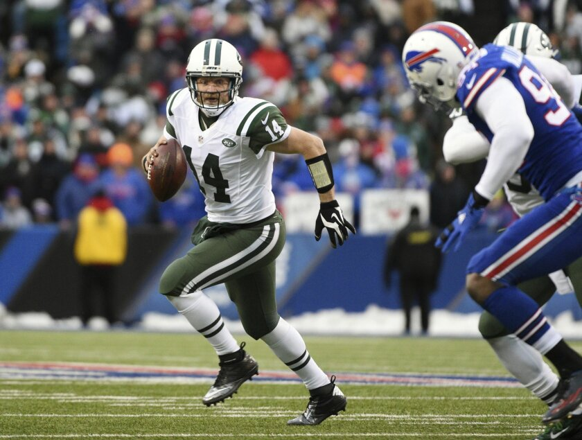 FILE - In this Jan. 3, 2016, file photo, New York Jets quarterback Ryan Fitzpatrick runs away from the Buffalo Bills pass rush during an NFL football game in Orchard Park, N.Y. The Jets have made an offer that Fitzpatrick–so far–has refused. A person familiar with the negotiations told The Associat