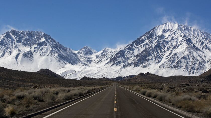 Snow blows from the crest of the Sierra Nevada in a view from Highway 168 near Aspendell, Calif., on March 12.