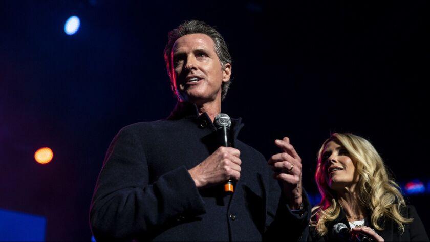SACRAMENTO, CALIF. - JANUARY 06: Governor-Elect Gavin Newsom and Jennifer Siebel Newsom speak before
