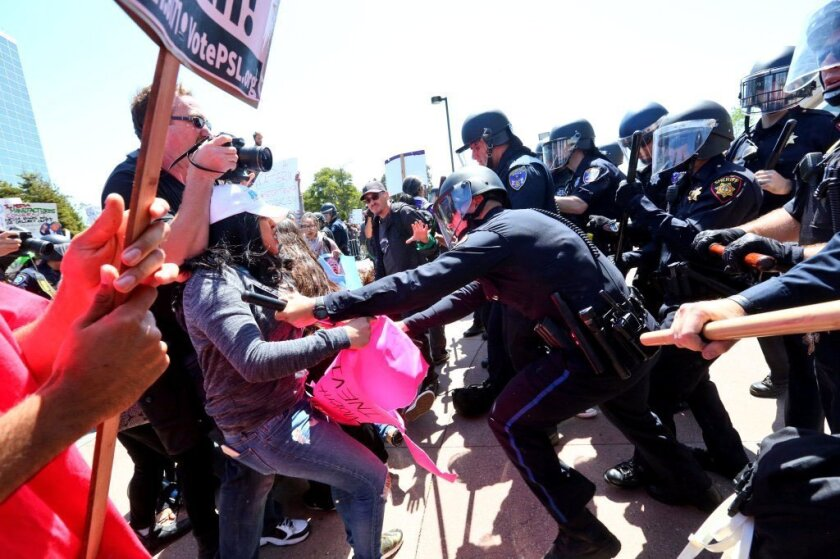 Protesters break through the barricade, rush for the entrance and clash with police.