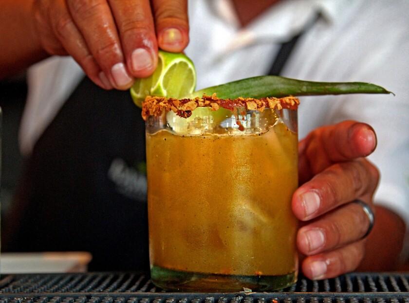 Danny Sanchez, head bartender at Rancho Pescadero in El Pescadero, makes an ancho chile and tequila cockail.