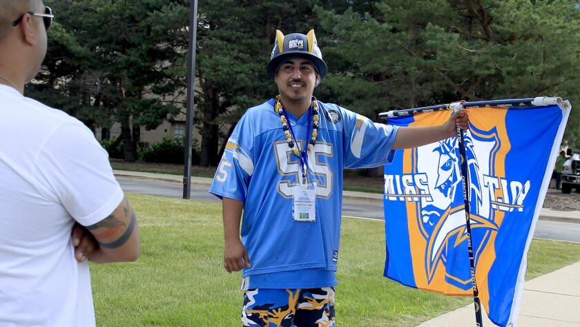 San Diego Chargers fan Johnny Abundez protests outside of the NFL owners meeting at the Hyatt Regency on Tuesday in Schaumburg, Ill.
