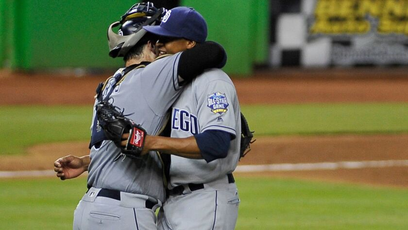 Padres pitcher Luis Perdomo, right, is congratulated after pitching a complete baseball game against the Miami Marlins in Miami, Aug. 28, 2016.