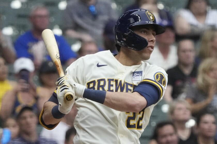 Milwaukee Brewers' Christian Yelich hits a three-run home run during the third inning of a baseball game against the Arizona Diamondbacks Thursday, June 3, 2021, in Milwaukee. (AP Photo/Morry Gash)