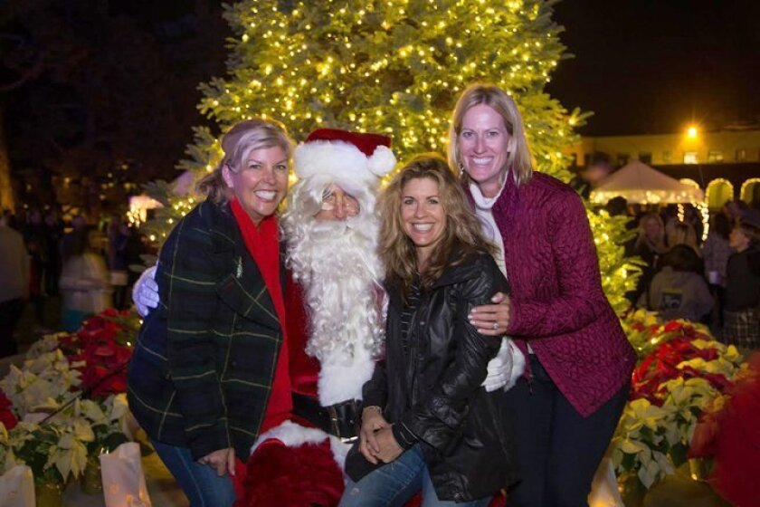 Santa Claus poses with The Bishop's School Tree Lighting co-chairs Kelli Fales and Jennifer Goldstone-Smith and Parents' Association president Barbara Edwards.