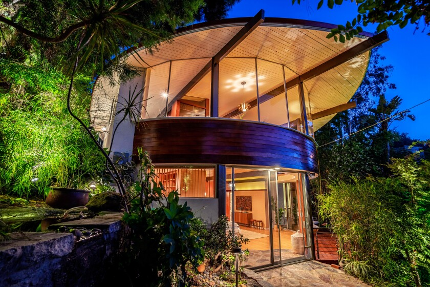 Built for animator and technician Ub E. Iwerks, the modernist home features original hardware, lighting built-ins. Noted architect John Lautner was originally tasked to design the home, which boasts a curvaceous exterior and walls of windows, but it was one of his assistants, James Charlton, who completed the project. Listed for $2.279 million, the home is concealed from the street by a blanket of mature landscaping. Meandering stone pathways are used to navigate the grounds, which feature secret gardens, patios a spa. (Shawn Cordon Real Estate Photography)
