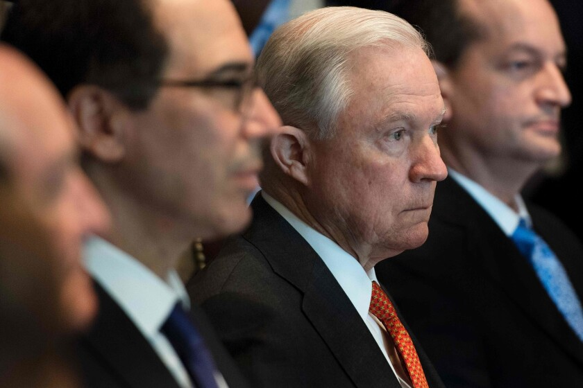 Attorney General Jeff Sessions listens as President Donald Trump speaks during a cabinet meeting at the White House on July 31, 2017.A White House spokesperson said Trump has no plans to remove Sessions from his position despite repeatedly attacking the attorney general on Twitter.