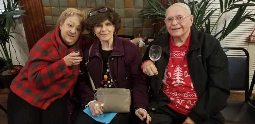 Peninsula Shepherd Center board members Janice Teixeira (left) and Jerry Sanders (right) take a seat with Carol Sanders (middle) to enjoy their drinks.