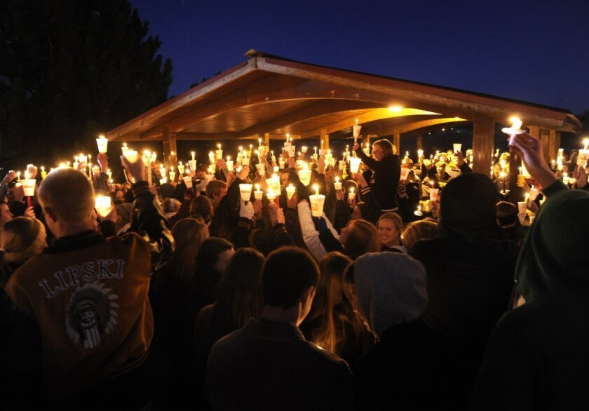 Hundreds of Arapahoe High School students attend a candlelight vigil Saturday night to share their prayers for Claire Davis, who was shot Friday inside the school. The vigil was held at Arapaho Park in Centennial, Colo., not far from the school.