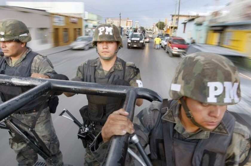 Troops patrol Ciudad Juarez, where 1,600 people were slain in 2008. The police chief quit in February after receiving threats and the same month, the governor survived an ambush.