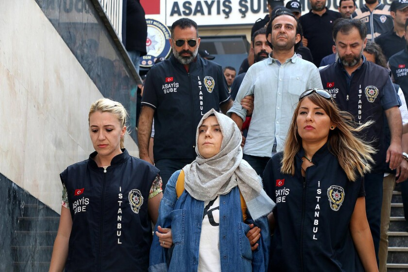 Police escort journalists to court, in Istanbul, Friday, July 29, 2016.