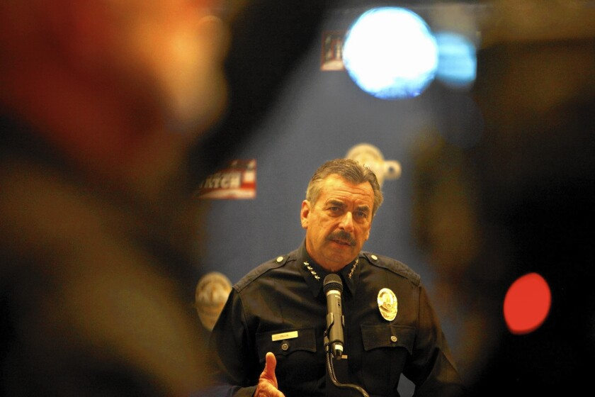 Los Angeles Police Chief Charlie Beck shown in 2014, dismissed an officer Tuesday who is sought in the fatal shooting of a man in Pomona.