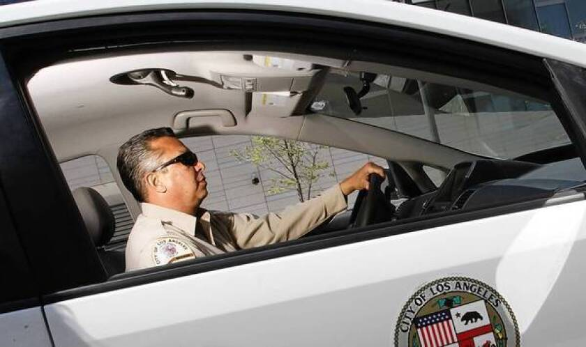 """Parking enforcement officer Richard Garcia has patrolled the streets of L.A. for 27 years. He sometimes feels like he's in a battle he can't win: """"There's just no more space and there's more and more vehicles."""""""