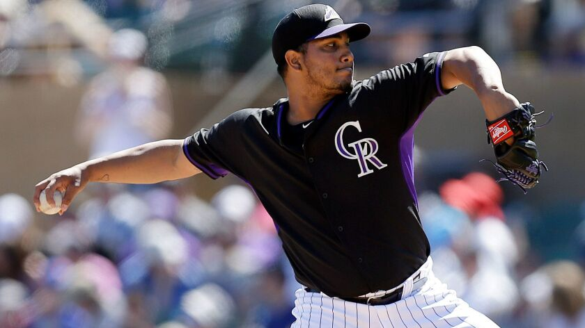 Colorado Rockies' Jhoulys Chacin throws the ball against the Los Angeles Dodgers in the first inning of a spring training exhibition baseball game Saturday, March 21, 2015, in Scottsdale, Ariz.