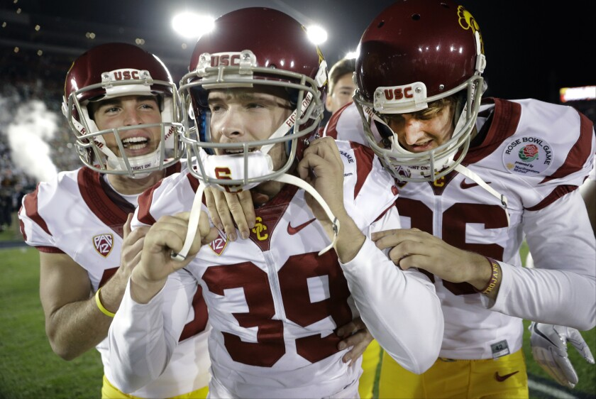 USC kicker Matt Boermeester, middle, from Cathedral Catholic, celebrates after the game-winning field goal against Penn State during a wild 52-49 Rose Bowl on Monday.
