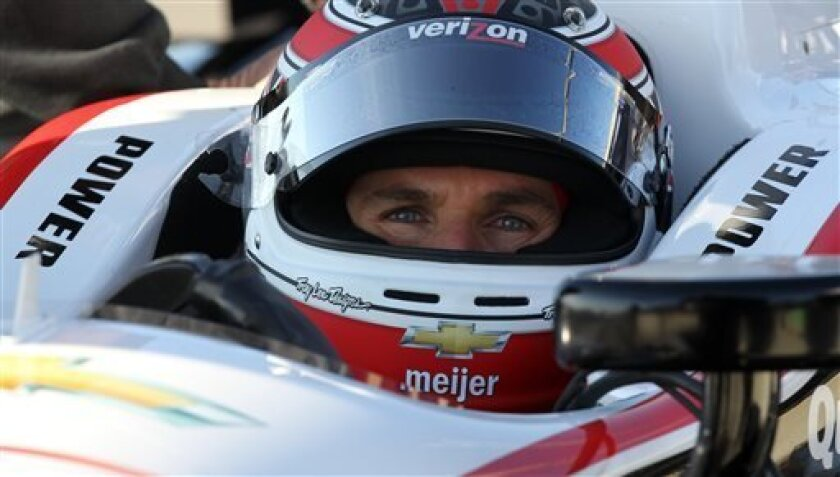Will Power, of Australia, sits in his car on pit road during practice for the IndyCar Grand Prix of Alabama on Saturday, April 6, 2013 in Birmingham, Ala. (AP Photo/Butch Dill)