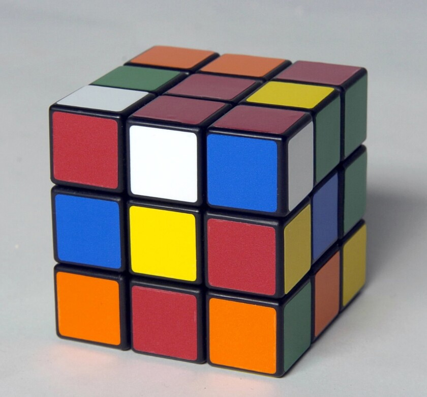 "You can use a Rubik's Cube to explain symmetry groups: Every rotation of the cube is a ""symmetry,"" and these combine into what mathematicians call a group."