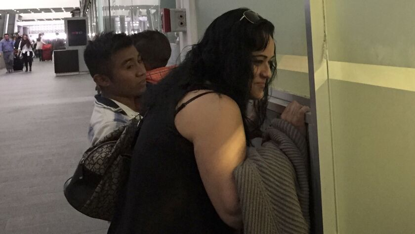 Claudia Arias looks for her husband, Mauricio Marino, who was deported to Mexico from Pennsylvania.