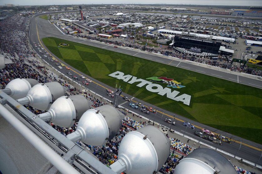 Dylan Kwasniewski (31) leads the field of drivers past the front grandstands at the start of the NASCAR Nationwide Series auto race at Daytona International Speedway in Daytona Beach, Fla., Saturday, Feb. 22, 2014. (AP Photo/Phelan M. Ebenhack)
