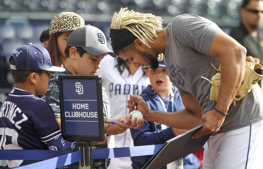 Fernando Tatis Jr. signs autographs after taking batting practice at Petco Park on May 7.