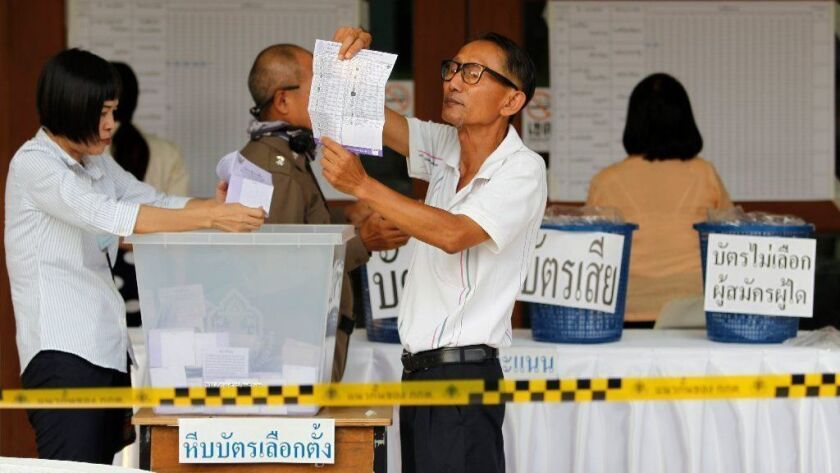 Electoral officials count ballots in Chiang Mai province after polls closed in Thailand's March 24, 2019, general elections.