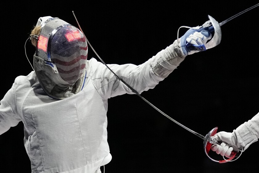 CORRECTS TO SOFYA VELIKAYA FROM OLGA NIKITA - Mariel Zagunis of the United States, left, and Sofya Velikaya of the Russian Olympic Committee compete in the women's individual Sabre quarterfinal competition at the 2020 Summer Olympics, Monday, July 26, 2021, in Chiba, Japan. (AP Photo/Andrew Medichini)