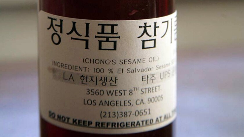 Chong's sesame oil, made from sesame seeds from El Salvador, is freshly pressed in the store.