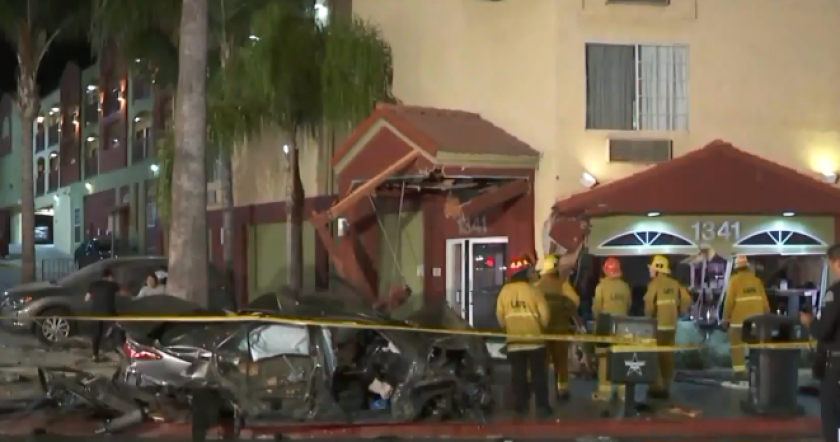 Two people were seriously injured when a car slammed into a Super 8 motel on Sunset Boulevard in Echo Park, police said.