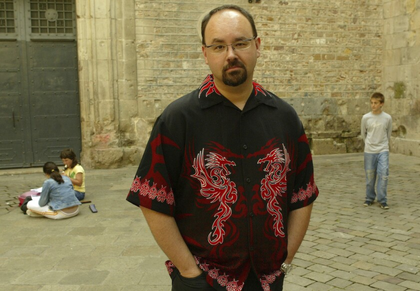 "In this Wednesday, May 26, 2004 photo, writer Carlos Ruiz Zafon poses in the Sant Felip Neri Square in the center of Barcelona, Spain. Spanish writer Carlos Ruiz Zafon, author of the acclaimed ""The Shadow of the Wind"", died at the age of 55 in Los Angeles, United States, it was announced Friday June 19, 2020. (AP Photo/Bernat Armangue)"