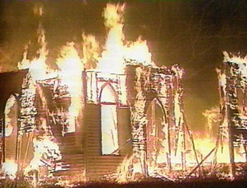 Fire engulfs a wooden sanctuary at a Presbyterian church in Charlotte, N.C., on June 6, 1996. Investigators said the attack was arson.
