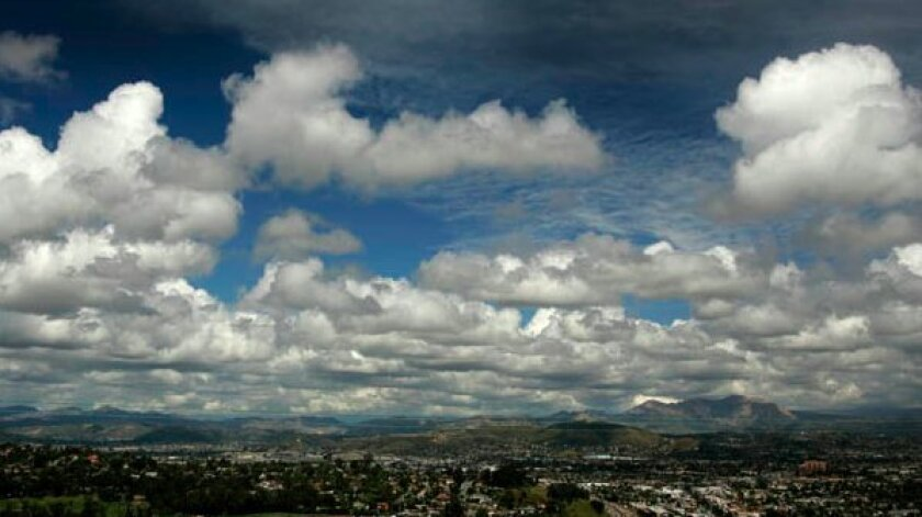 Billowing clouds above East County as seen from Sunset Avenue in the Mount Helix area of San Diego County on Monday.