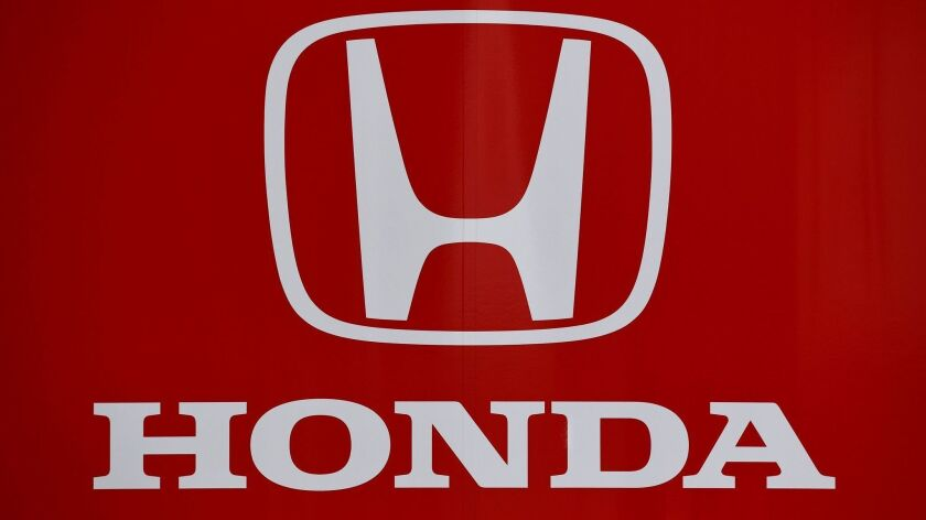 The logo of Japanese automobile manufacturer Honda is seen at the Autodromo Nazionale circuit in Monza. General Motors and Honda have joined forces with the tech firm Cruise to develop autonomous vehicles as the race to market self-driving cars continues.