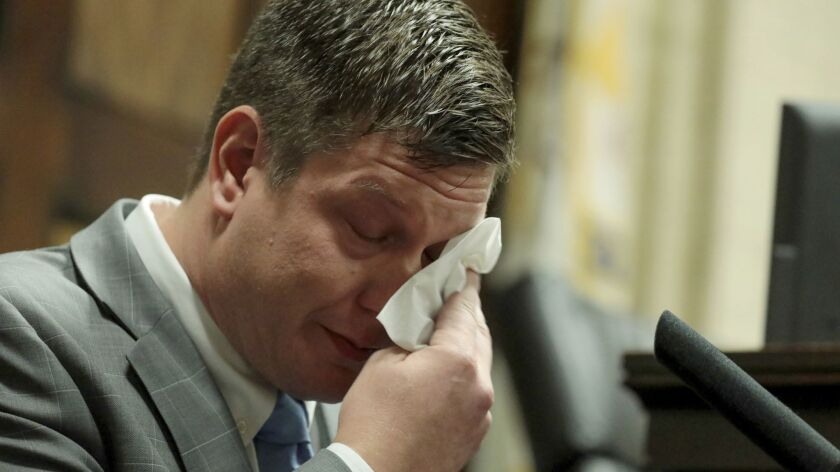 Chicago Police Officer Jason Van Dyke dabs his eyes as he testifies in his murder trial Tuesday in Chicago.