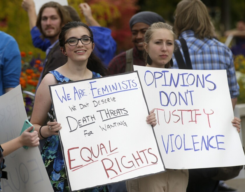 Mikaila Young, left, and Shannon Rigby protest at Utah State University after feminist speaker Anita Sarkeesian canceled an appearance when she learned that audience members could bring concealed firearms to the event despite an anonymous threat against her.