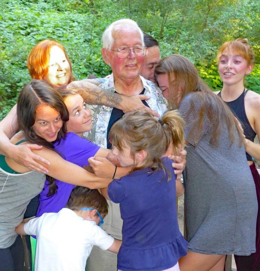 Jim Jackson joins a group hug including three of his grandchildren and his five great-grandchildren in 2016.