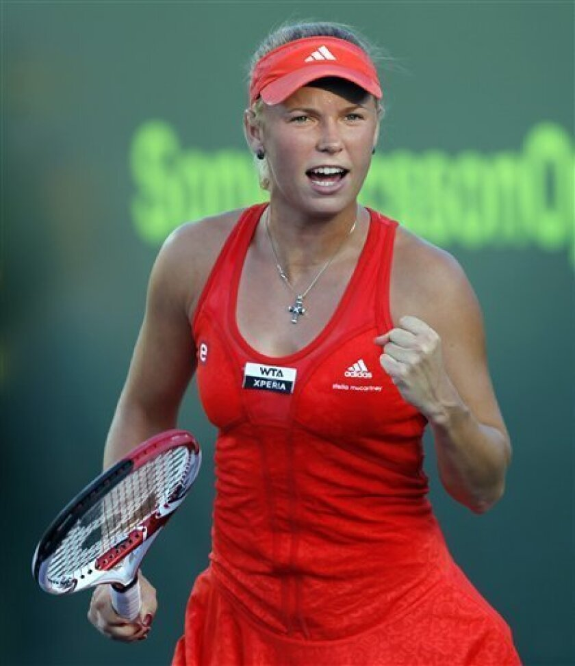 Caroline Wozniacki, of Denmark, celebrates after winning the first set in a tiebreaker against Yanina Wickmayer, of Belgium, during the Sony Ericsson Open tennis tournament in Key Biscayne, Fla., Monday, March 26, 2012. (AP Photo/Alan Diaz)