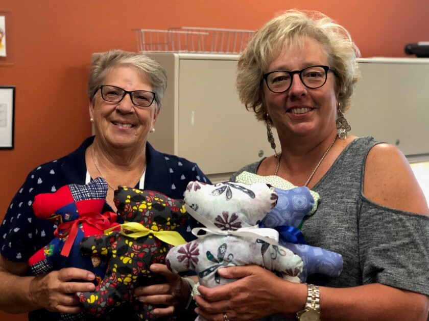 Members of GFWC Contemporary Women of North County made 60 teddy bears for children receiving medical and dental services at the Vista Community Clinic. Kathy Michaels (left), a member of the North County group, recently delivered the handmade bears to Betsy Heightman (right), chief development officer at Vista Community Clinic. Visit cwonc.org.