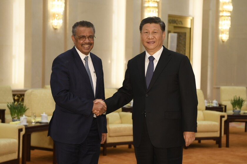 "FILE - In this Jan. 28, 2020, file photo, Tedros Adhanom, director general of the World Health Organization, left, shakes hands with Chinese President Xi Jinping before a meeting at the Great Hall of the People in Beijing. Throughout January, the World Health Organization publicly praised China for what it called a speedy response to the new coronavirus. It repeatedly thanked the Chinese government for sharing the genetic map of the virus ""immediately"" and said its work and commitment to transparency were ""very impressive, and beyond words."" But behind the scenes, there were significant delays by China and considerable frustration among WHO officials over the lack of outbreak data, The Associated Press has found. (Naohiko Hatta/Pool Photo via AP, File)"