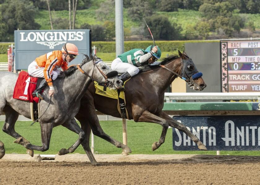 Jockeys use the riding crop, or whip, during a race at Santa Anita.