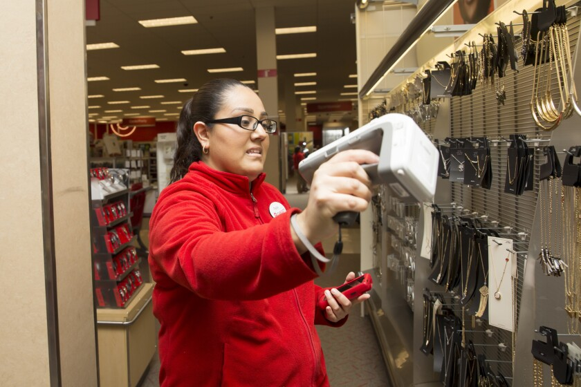Target employee Paola Lopez scans radio frequency identification tags on merchandise throughout the store, Thursday, Jan. 26, 2017, at a Target store in Oak Lawn. The radio frequency identifications tags, or RFID, help the retailer better locate and track items within their inventory. Lopez has been working for the retailer for about 2 years. (Alyssa Pointer/ Chicago Tribune)